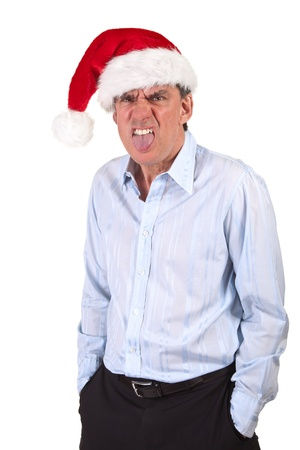 Grumpy Frowning Business Man in Christmas Santa Hat sticking out tongue