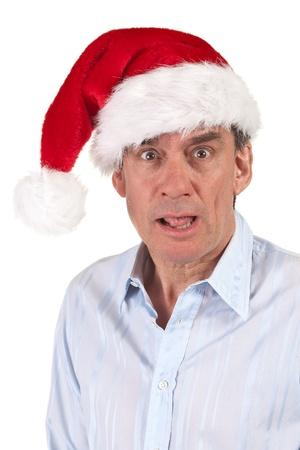 Headshot Portrait of Shocked Surprised Man in Christmas Santa Hat photo