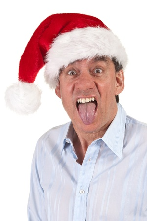 Headshot Portrait of Man in Christmas Santa Hat Sticking Out Tongue Stock Photo - 11182914