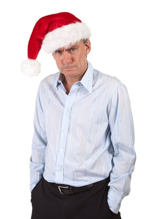Portrait of Grumpy Frowning Angry Business Man in Christas Santa Hat Bah Humbug