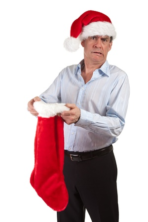 Man in Santa Hat Horrified at contents of Christmas Stocking photo
