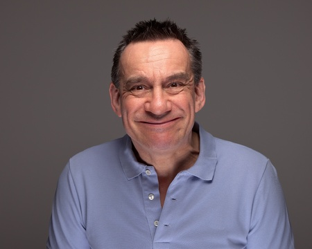 Handsome Middle Age Man Pulling Silly Face Grinning on Grey Background