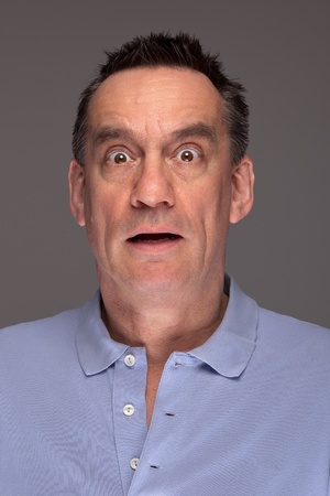 Portrait of Shocked Scared Middle Age Man on Grey Background photo
