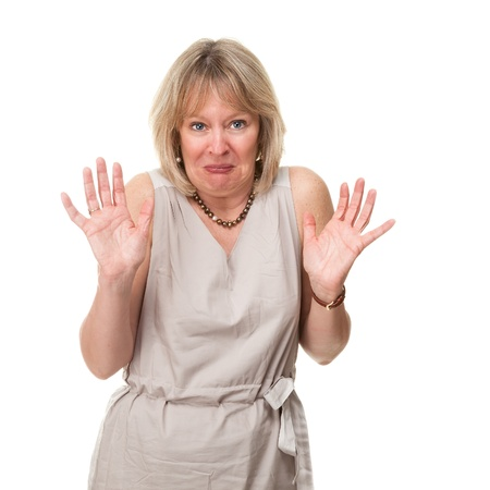 Attractive Mature Woman with Shocked Horrified Expression Holding up Hands Isolated photo