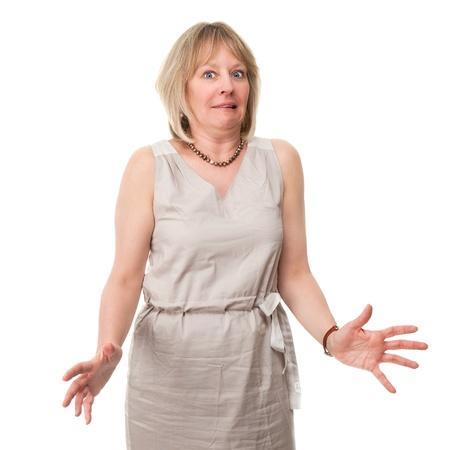 sgomento: Attraente donna matura con Expression Scared Holding Hands Out isolato Archivio Fotografico