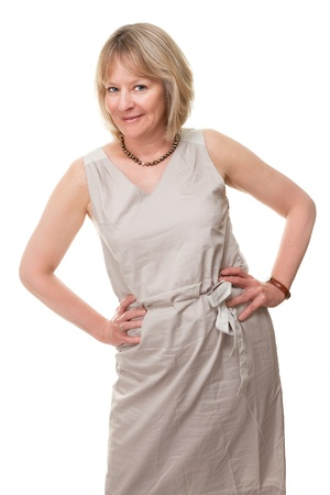 Portrait of Happy Attractive Mature Woman with Hands on Hips Isolated