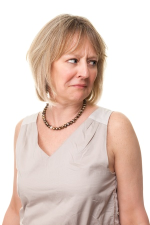 looking over shoulder: Attractive Mature Woman Looking Over Shoulder with Worried Expression Isolated