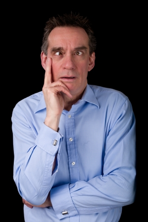 frowning: Middle Age Business Man Pulling Funny Cross Eyed Face Black Background Stock Photo