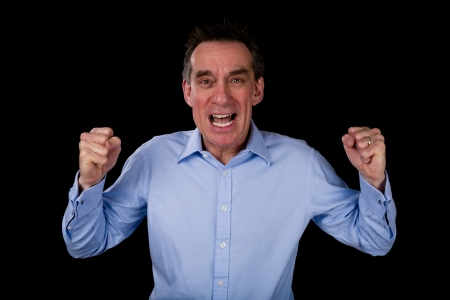 Angry Shouting Middle Age Business Man Shaking Fists Black Background photo