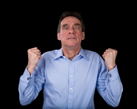 blue eyed: Frustrated Middle Age Business Man Shaking Fists in Anger Black Background Stock Photo