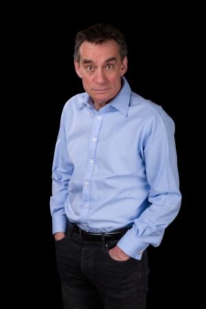 mid adult men: Surprised Shocked Staring Middle Age Business Man in Blue Shirt Black Background