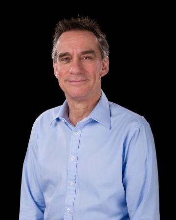 Portrait of Handsome Smiling Middle Age Business Man in Blue Shirt Black Background