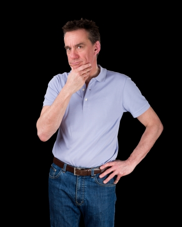 Thoughtful Middle Age Man Considering Something Hand on Hip Black Background photo