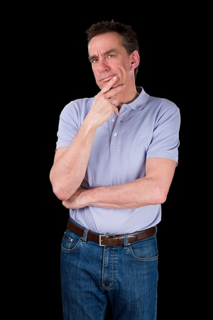 Pensive Middle Age Man with Hand to Chin in Thought Black Background photo
