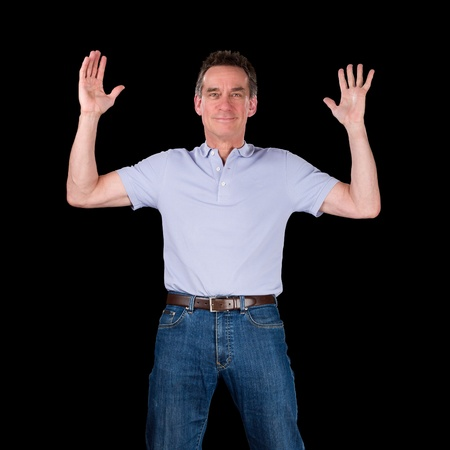 Happy Excited Middle Age Man Hands Raised in Air Black Background photo
