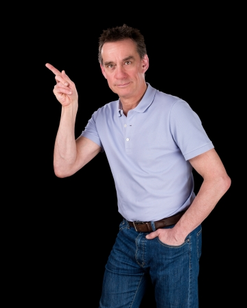 Handsome Middle Age Man Pointing At Something Black Background photo