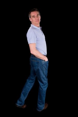 looking over shoulder: Middle Age Man Looking Backwards Over Shoulder Black Background