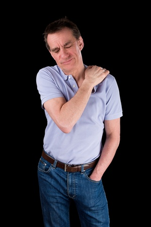 Middle Age Man Holding Shoulder in Pain Black Background Stock Photo - 19358877