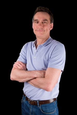 smug: Portrait of Smiling Happy Middle Age Man Arms Folded Black Background