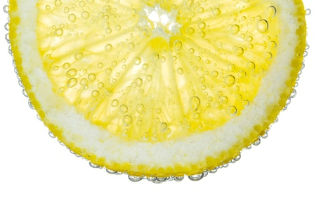 lemon water: Lemon Slice in Clear Fizzy Water Bubble Background Isolated