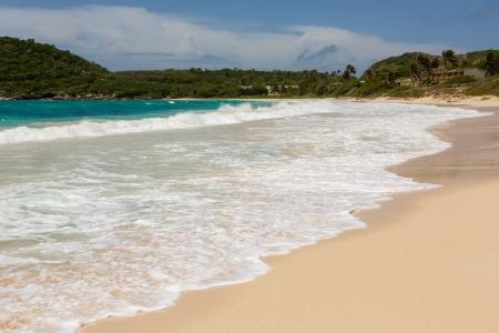 Atlantic Waves Crashing on Beach at Half Moon Bay Antigua Stock Photo - 22443259