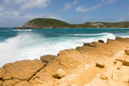 Waves Crashing on Rocky Limestone Coastline at Half Moon Bay Antigua Stock Photo - 22443265
