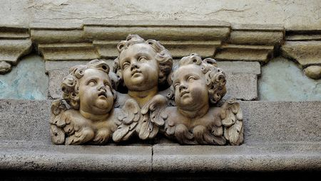 Faces of cherubs carved in marble Stock Photo