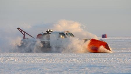 drifting ice: Snow Plow on a frozen lake Stock Photo