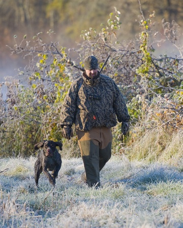 wirehair: Hunter with his dog Stock Photo