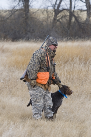 drahthaar: Hunter with his dog Stock Photo