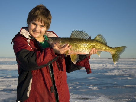 ice fishing: Boy with Walleye Stock Photo