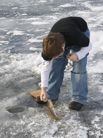 Boy Ice Fishing Stock Photo - 17889531