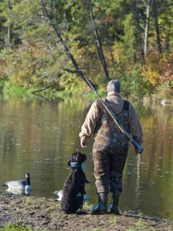 Goose Hunter with a dog Stock Photo