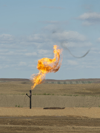 Natural Gas flame from an oil well photo