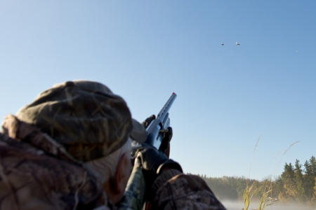 Hunter Shooting at ducks