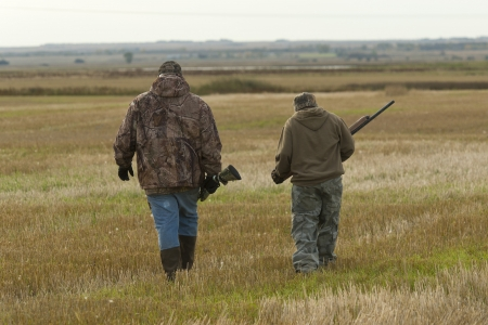 Father and son hunting Standard-Bild