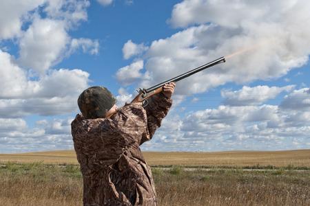 muzzleloader: Hunter Shooting a Muzzleloader Shotgun Stock Photo