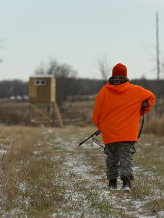 Hunter walking to his deer stand