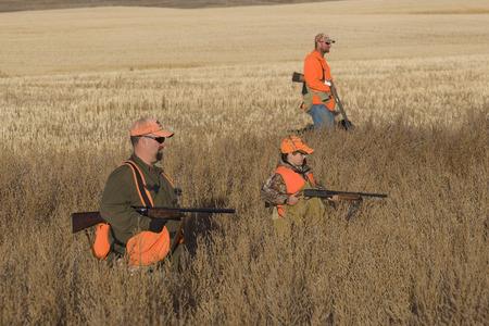 Vater und Sohn-Jagd Standard-Bild