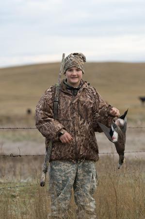 dead duck: Duck Hunter Stock Photo