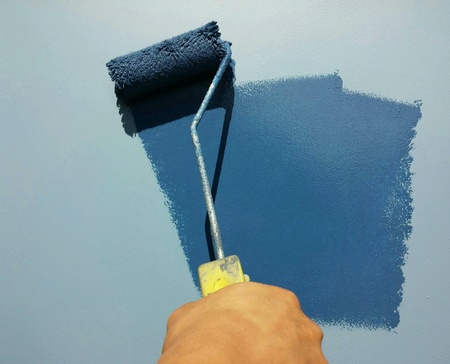Painters painted blue wall Stock Photo