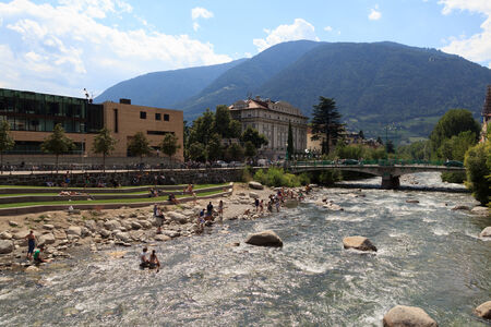 meran: People bathing in the sun at the river Passer in Meran Editorial