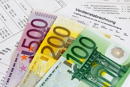 taxable: German payroll with euro banknotes Stock Photo