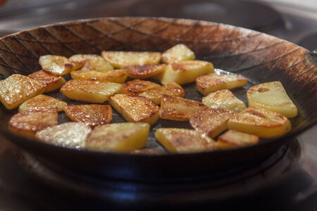 hefty: Chip potatoes in iron frying pan