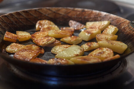 chippy: Chip potatoes in iron frying pan