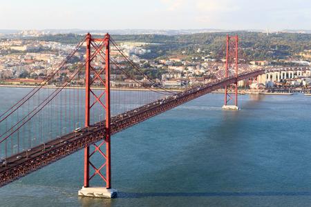 25 de Abril Bridge and Lisbon cityscape Stock Photo