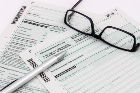 taxman: Form of income tax return with ball pen and glasses Stock Photo