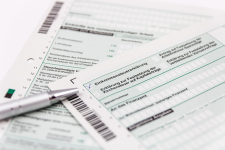 Form of income tax return with ball pen and short depth of sharpness Stock Photo
