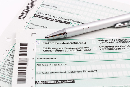 taxman: Form of income tax return with ball pen Stock Photo