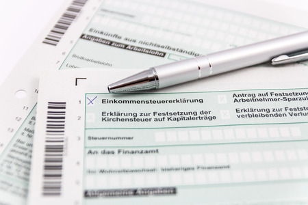 statutory: Form of income tax return with ball pen and short depth of sharpness Stock Photo